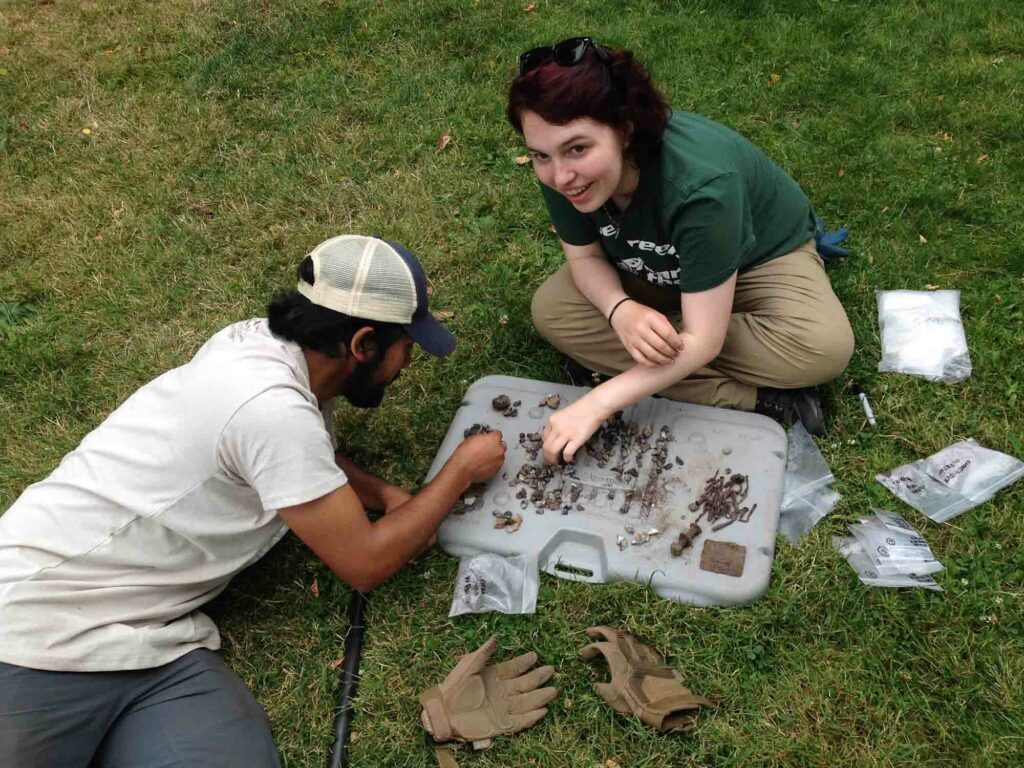 Field School students surveying the waterfront in 2016 examining artifacts