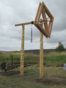Newly Reconstructed Beef Wheel in 2019 with a metal chain and hooks hanging from the top crossbeam